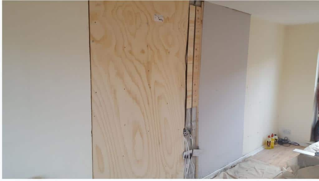 Supporting existing wall with plywood