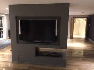 fireplace installation with TV unit work in progress